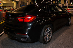 CHARLOTTE, NORTH CAROLINA - NOVEMBER 20, 2014: BMW X6 sports activity vehicle on display during the 2014 Charlotte International Auto Show at the Charlotte Convention Center.