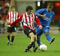 Photo. Andrew Unwin<br /> Sunderland v Cardiff City, Nationwide League Division One, Stadium of Light, Sunderland 14/10/2003.<br /> Cardiff's Richard Langley (r) looks to challenge Sunderland's Julio Arca (l).