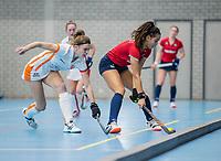 ROTTERDAM -  Yasmin Geerlings (Hurley) ,met Kim Janssens (OR) .dames Hurley-Oranje Rood, Hurley plaatst zich voor halve finales NK  ,hoofdklasse competitie  zaalhockey.   COPYRIGHT  KOEN SUYK