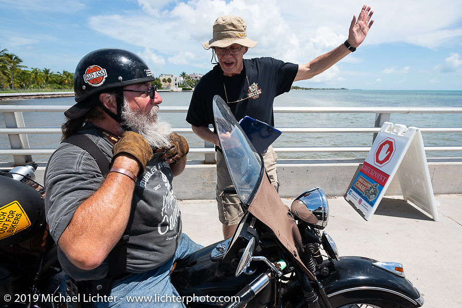 Willie Earhart pulls into the staging area before the finish on his 1948 Harley-Davidson Panhead during the Cross Country Chase motorcycle endurance run from Sault Sainte Marie, MI to Key West, FL. (for vintage bikes from 1930-1948). The staging area on a Key West pier just before the finish and near the end of the 110 mile Stage-10 ride from Miami to Key West, FL USA. Sunday, September 15, 2019. Photography ©2019 Michael Lichter.
