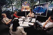 "Pacific Data Images (PDI) morning conference. The company does computer animation and digital film effects: morphing.  1992 at the office in Sunnyvale, California. In 1996 PDI began collaborating with DreamWorks SKG, which then acquired PDI in 2004. .Creating believable 3D animated characters (War Games) and seamless transformations known as morphing (""Black and White"" and ""She's Mad""), PDI has been at the forefront of computer imagery. The studio pushed the boundaries of morphing in Michael Jackson's video ""Black or White"" with a sequence of twelve dynamic transformations of moving characters. In the innovative David Byrne video ""She's Mad,"" PDI pioneered the technology called performance animation, capturing the motion of David Byrne and infusing an animated character with his distinctive motion."