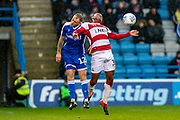 Gillingham FC defender Barry Fuller (12) and Doncaster Rovers forward Niall Ennis (31) during the EFL Sky Bet League 1 match between Gillingham and Doncaster Rovers at the MEMS Priestfield Stadium, Gillingham, England on 15 February 2020.