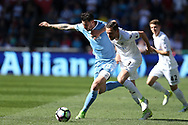 Gylfi Sigurdsson of Swansea city holds off Geoff Cameron of Stoke city (l).  Premier league match, Swansea city v Stoke City at the Liberty Stadium in Swansea, South Wales on Saturday 22nd April 2017.<br /> pic by Andrew Orchard, Andrew Orchard sports photography.
