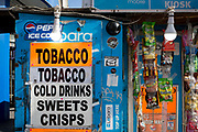A detail of a street vendors kiosk notices for tobacco, drinks and other confectionary, on 5th March 2019, in London, England.