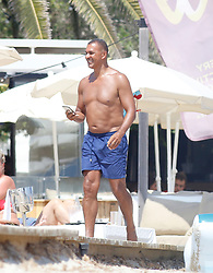 Ruud Gullit in bathing suit and his wife Maggie Jimenez in bikini are seen on the beaches of Ibiza while they enjoy their holidays in Ibiza on August 4, 2017 in Ibiza, Spain. The former Dutch footballer is sharing the same building in Ibiza with his ex wife model Estelle Cruyff, which are also in Ibiza. 04 Aug 2017 Pictured: Ruud Gullit. Photo credit: Elkin Cabarcas / MEGA TheMegaAgency.com +1 888 505 6342
