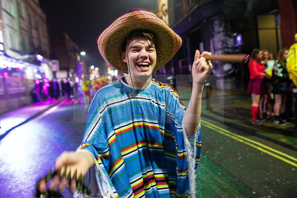 © Licensed to London News Pictures . 26/12/2018. Wigan, UK. Revellers in Wigan enjoy Boxing Day drinks and clubbing in Wigan Wallgate . In recent years a tradition has been established in which people go out wearing fancy-dress costumes on Boxing Day night . Photo credit: Joel Goodman/LNP