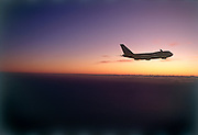 Airplane in silhouette at sunset
