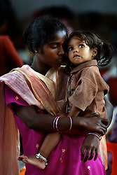 Nirumala holds her sister Varun Kumar, 3, inside a camp set up for those who lost their homes in the tsunamis that ravaged the coast of India and Asia January 1, 2005 in Nagapattinum, Tamil Nadu, India.