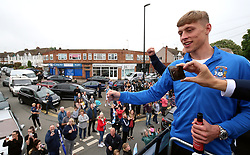 Coventry City's Tom Davies (right) during the Sky Bet League Two promotion parade in Coventry.