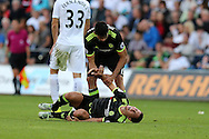 Diego Costa of Chelsea helps his teammate Eden Hazard to his feet after Hazard was fouled.  Premier league match, Swansea city v Chelsea at the Liberty Stadium in Swansea, South Wales on Sunday 11th Sept 2016.<br /> pic by  Andrew Orchard, Andrew Orchard sports photography.