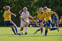 Laconia's Morgan Gamans charges through Kearsarge defenders Maggie Lee, Taylor Albright and Anna Stowel during NHIAA Division III soccer Wednesday afternoon.  (Karen Bobotas/for the Laconia Daily Sun)