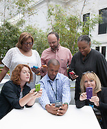 Networking group checking their phones