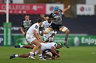 Dan Biggar of the Ospreys (on ground) is tackled by Sebastien Vahaamahina of Clermont Auvergne as Justin Tipuric of the Ospreys © jumps in support.  .European Rugby Champions Cup, pool 2 match, Ospreys v ASM Clermont Auvergne at the Liberty Stadium in Swansea, South Wales on Sunday 15th October 2017.<br /> pic by  Andrew Orchard, Andrew Orchard sports photography.