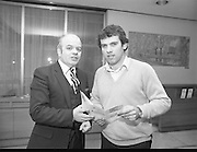 Tony Ward Gives Blood..1984.16.03.1984.03.16.1984.16th March 1984..With a possible shortage of blood over the St Patrick's Weekend,Tony Ward,Irish Rugby International,led an awareness campaign by donating blood. He attended The Blood Transfusion Service,Pelican House,Mespil Road,Dublin...Image of Tony Ward being greeted by the director on his arrival at Pelican House.Tony,a regular donor himself,was hoping to encourage regular and new donors to attend to ensure adequate supplies of blood for Irish hospitals at such a busy period.