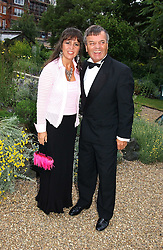 TONY & DEBBIE BLACKBURN at a fund raising event for The Galapagos Conservation Trust entitled 'Some Enchanted Evening' at the Chelsea Physic Garden Chelsea, London on 17th June 2004.