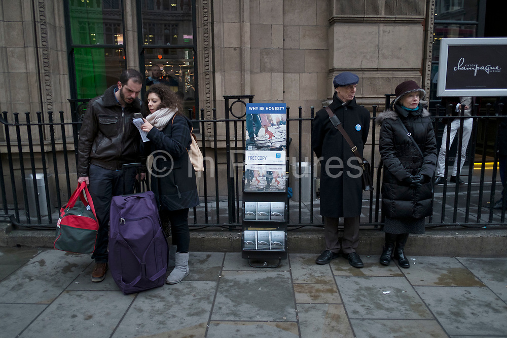 The Watchtower being handed out in the City of London, UK. The Watchtower Announcing Jehovah's Kingdom is an illustrated religious magazine, published monthly in 254 languages by Jehovah's Witnesses. Along with its companion magazine, Awake!, Jehovah's Witnesses distribute The Watchtower Public Edition in their door-to-door ministry, and is the most widely circulated magazine in the world, with an average print run of approximately 59 million copies bimonthly, as of 2016.