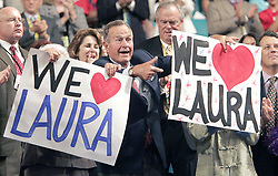 Former President George H.W. Bush holds up a sign during his daughter-in-law Laura's address to the 2004 Republican National Convention at Madison Square Garden in New York City, on Tuesday, August 31, 2004. Photo by Gary Dunkin/KRT/ABACA.