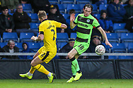 Forest Green Rovers Theo Archibald(18) takes on Oxford United's Cameron Norman(2) during the The FA Cup 1st round match between Oxford United and Forest Green Rovers at the Kassam Stadium, Oxford, England on 10 November 2018.