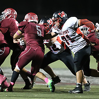 (Photograph by Bill Gerth for SVCN) Westmont #71 John Bayley makes the stop  vs San Jose in a BVAL Football Game at San Jose High School, San Jose CA on 10/7/16.  (Westmont 28 San Jose 20)
