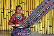 Long threads are attached to a rustic loom made of ropes and sticks which is strapped to the women´s back.  Textiles made with this technique are usually long and narrow as their width is limited.