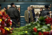 Moscow, Russia, 30/03/2010..Moscow Metro commuters stare at a makeshift shrine on the spot inside Park Kultury metro station where a female suicide bomber blew herself up the previous day. At least 39 people were killed and 80 injured in the double blasts at Moscow metro stations during the morning rush hour.