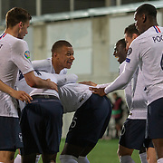ANDORRA LA VELLA, ANDORRA. June 1. Kurt Zouma #15 of France is congratulated by team mates after scoring his sides fourth goal during the Andorra V France 2020 European Championship Qualifying, Group H match at the Estadi Nacional d'Andorra on June 11th 2019 in Andorra (Photo by Tim Clayton/Corbis via Getty Images)