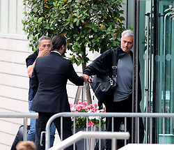 Manchester United manager Jose Mourinho arrives back at The Lowry Hotel on Monday evening and misses the Everton Team leaving for their clash with Man City by 60 seconds. Jose touches fists with a hotel worker.