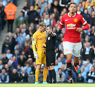 Manchester City's Joe Hart confronts referee Michael Oliver as Manchester United's Chris Smalling gets a yellow card<br /> <br /> - Barclays Premier League - Manchester City vs Manchester Utd - Etihad Stadium - Manchester - England - 2nd November 2014  - Picture David Klein/Sportimage