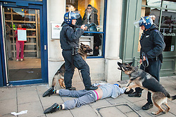 © Licensed to London News Pictures . 07/08/2011 . London , UK . Police with dogs in Enfield at the start of a 2nd night of rioting and looting in London , which followed a protest against the police shooting of Mark Duggan . Photo credit : Joel Goodman/LNP