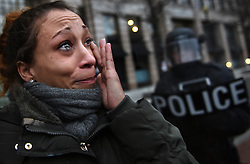 January 20, 2017 - Washington, DC, U.S - DOMINIQUE BROWN from Omaha Nebraska weeps as protesters and police clash during President Donald Trump's inauguration in Washington, D.C., on Jan. 20, 2017   ''I can't believe this is our country.  It hurts,'' she declares.  ''This is the same fight our ancestors fought...There are enlightened humans and ignorant ones.  Ignorance doesn't have a color.  If my heart can beat in your chest, we're good.''  The election of Donald Trump has erupted in street protests and a great divide of opinions and values  in the American population. (Credit Image: © Carol Guzy via ZUMA Wire)