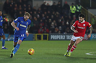 AFC Wimbledon midfielder Mitchell (Mitch) Pinnock (11) dribbling during the EFL Sky Bet League 1 match between AFC Wimbledon and Barnsley at the Cherry Red Records Stadium, Kingston, England on 19 January 2019.
