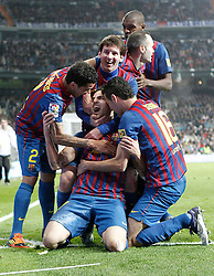 10.12.2011, Santiago Bernabeu Stadion, Madrid, ESP, Primera Division, Real Madrid vs FC Barcelona, 15. Spieltag, im Bild Barcelona's Cesc Fabregas celebrates wth Lionel Messi, Daniel Alves, Andres Iniesta and Eric Abidal // during the football match of spanish 'primera divison' league, 15th round, between Real Madrid and FC Barcelona at Santiago Bernabeu stadium, Madrid, Spain on 2011/12/10. EXPA Pictures © 2011, PhotoCredit: EXPA/ Alterphotos/ Alvaro Hernandez..***** ATTENTION - OUT OF ESP and SUI *****