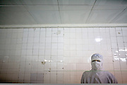 A Chinese worker stands guard at the Tianyang Food Processing Ltd. dumpling factory in Shijiazhuang, in China's Hebei province Friday Feb. 15, 2008. Traces of methamidophos, an insecticide banned in Japan, were found in the dumplings, on the packaging and in the vomit of the 10 people who were sickened after eating two separate brands of Tianyang dumplings. With China increasingly intertwined in global trade, Chinese exporters are paying a price for unsafe practices. Excessive antibiotic or pesticide residues have caused bans in Europe and Japan on Chinese shrimp, honey and other products.