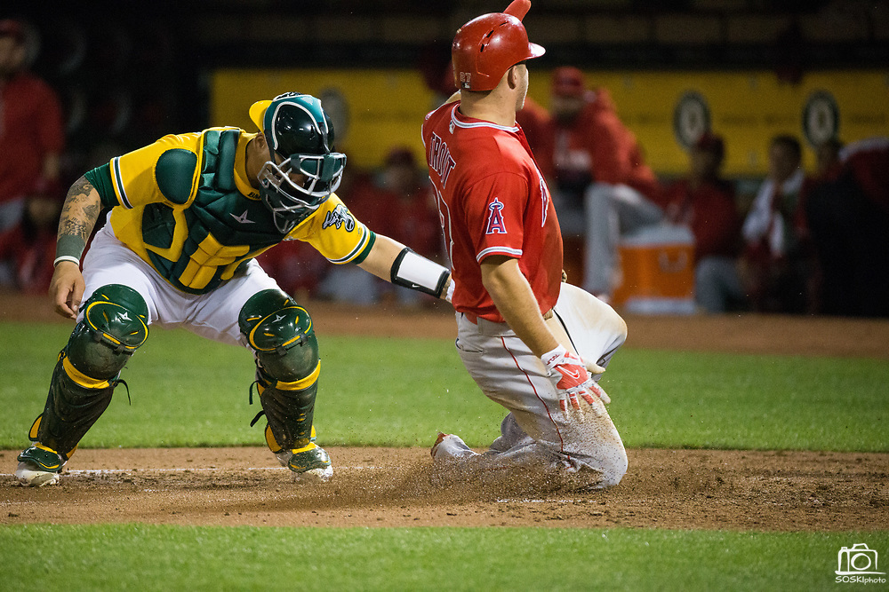 Oakland Athletics catcher Bruce Maxwell (13) tags out Los Angeles Angels center fielder Mike Trout (27) at home plate at Oakland Coliseum in Oakland, California, on September 5, 2017. (Stan Olszewski/Special to S.F. Examiner)