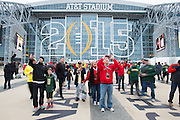 Fans take selfies at AT&T Stadium befor the College Football Playoff National Championship Game on January 12, 2015 in Arlington, Texas.  (Cooper Neill for The New York Times)