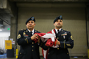United States Army Sergeant First Class Henry Romero, left, and Steve Duran carry the American Flag in the tunnel before Game 1 of the Western Conference Semifinals between Golden State Warriors and Utah Jazz at Oracle Arena in Oakland, Calif., on May 2, 2017. (Stan Olszewski/Special to S.F. Examiner)