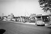 09/08/1967<br /> 08/09/1967<br /> 09 August 1967<br /> Opening of Esso service station at Dean's Grange, Dublin. The site was originally a sculptures yard was a 2-bay service station with the latest equipment. It was to be a 24 hours station and a 5-minute Car Wash and Electronic Tuning was available. A general view of the station, with Volkswagen Beatle.