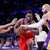 27 January 2015: Washington Wizards forward Martell Webster (9) drives past Los Angeles Lakers forward Wesley Johnson (11) and Los Angeles Lakers forward Carlos Boozer (5) during the Washington Wizards 98-92 victory over the Los Angeles Lakers, at the Staples Center, Los Angeles, California, USA.