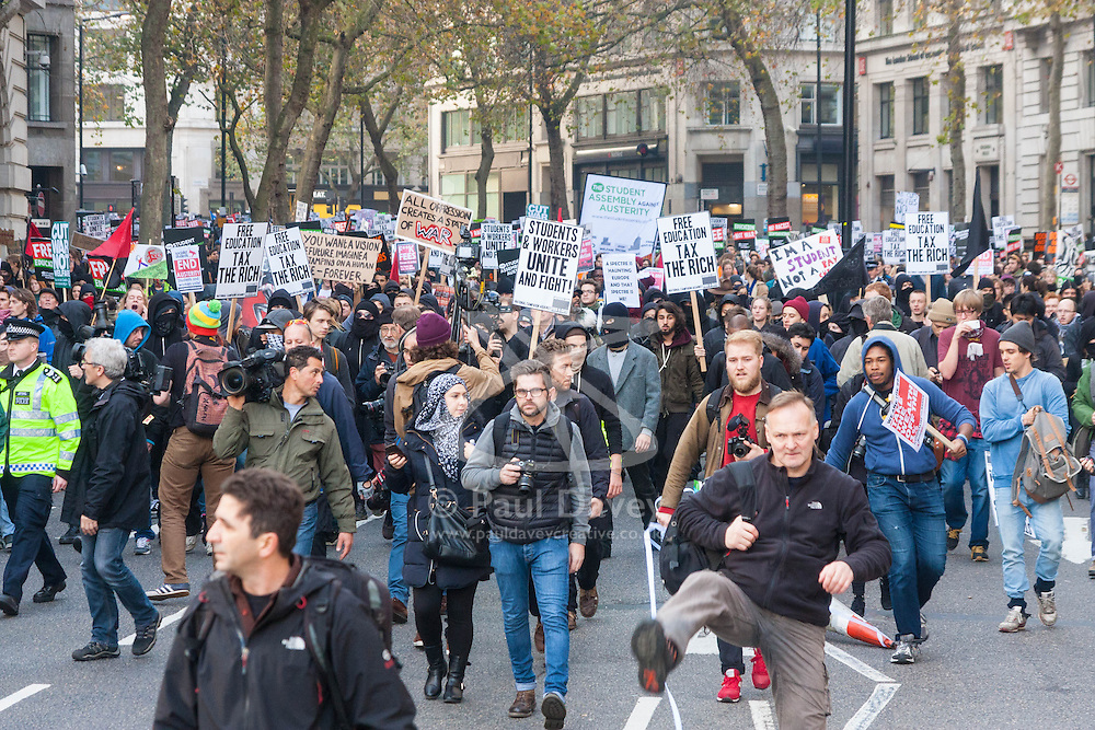 London, November 19th 2014. Thousands of students march through central London, demanding that education fees are scrapped by the government. PICTURED: Students march along Aldwych on their way to Parliament.
