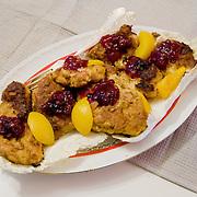 Turkey schnitzel <br /> Serves 2 for 2 days <br /> <br /> Ingredients: 700gr breast turkey<br /> 3 tablespoons corn oil<br /> 1 onion<br /> ½ teaspoon turkey ready-mix herbs <br /> 1 lemon peel <br /> 1 tablespoon honey<br /> 1 egg<br /> 1 dry bread roll<br /> 1 teaspoon corn flour <br /> 1 tin peaches <br /> 2 teaspoons cranberry<br /> ½ cup vegetable oil <br /> <br /> <br /> Preparation :<br /> 1.Cut the turkey in 8 pieces<br /> 2.Marinade the turkey in 3 tablespoons of corn oil, 1 finely chopped onion, herbs, the lemon peel and one tablespoon honey for 2hrs<br /> 3.Mix the egg <br /> 4.Grind the bread and mix with corn flour<br /> 5.Put the turkey in the egg and then crumb it <br /> 6.Fry the turkey in ½ cup of vegetable oil until turns brown<br /> 7.Serve with peaches and cranberry