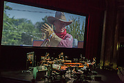 Brooklyn, NY - 20 January 2015. The dress rehearsal of Sufjan Stevens' Round-Up, with slow motion film of the Pendleton, Oregon Round-Up by Aaron and Alex Craig, music performd by Sufjan Stevens and Yarn/Wire. Musicians (L to R) Russell Greenberg, Ning Yu (piano), Ian Antonio, Sufjan Stevens (in the blue cap), Laura Barger (piano).