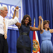"""Democrat Charlie Crist, First Lady Michelle Obama and Annette Taddeo celebrate after the """"Commit to Vote"""" rally for Democrat Charlie Crist who is running for Governor of the state of Florida. The campaign called on the event to """" energize voters and lay out the stakes for Floridians in the critical election on November 4th."""" at the Barnett Park Gymnasium in Orlando, Florida on Friday, Nov. 17, 2014. (AP Photo/Alex Menendez)"""