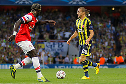 27.08.2013, Emirates Stadion, London, ENG, UEFA CL Qualifikation, FC Arsenal vs Fenerbahce Istanbul, Rueckspiel, im Bild Arsenal's Bacary Sagna and Fernerbache's Caner Erkin during the UEFA Champions League Qualifier second leg match between FC Arsenal and Fenerbahce Istanbul at the Emirates Stadium, United Kingdom on 2013/08/27. EXPA Pictures © 2013, PhotoCredit: EXPA/ Mitchell Gunn<br /> <br /> ***** ATTENTION - OUT OF GBR *****
