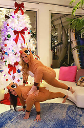 """Coco Austin releases a photo on Twitter with the following caption: """"""""...and of course my sister made me get in some kinda of yoga pose in our reindeer outfits(we do this every time we see each other)<br /> #lizardpose <br /> #christmas2018"""""""". Photo Credit: Twitter *** No USA Distribution *** For Editorial Use Only *** Not to be Published in Books or Photo Books ***  Please note: Fees charged by the agency are for the agency's services only, and do not, nor are they intended to, convey to the user any ownership of Copyright or License in the material. The agency does not claim any ownership including but not limited to Copyright or License in the attached material. By publishing this material you expressly agree to indemnify and to hold the agency and its directors, shareholders and employees harmless from any loss, claims, damages, demands, expenses (including legal fees), or any causes of action or allegation against the agency arising out of or connected in any way with publication of the material."""