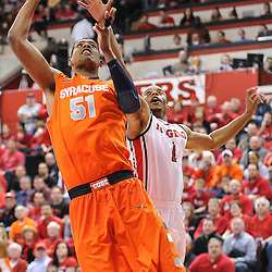 Syracuse Orange center Fab Melo (51) jumps for a layup past Rutgers Scarlet Knights guard Jerome Seagears (1) during first half NCAA Big East basketball action between #2 Syracuse and Rutgers at the Louis Brown Athletic Center. Syracuse leads 40-34 at halftime.