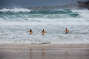 Sydney, Australia. Sunday 24th May 2020. Bondi Beach in Sydney's Eastern suburbs experiences very rough surf conditions today with  massive waves. Poeple braving the surf with coronavirus restrictions eased to swim and exercise only.