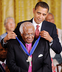 US President Barack Obama presents the Presidential Medal of Freedom to South African Archbishop Emeritus Desmond Mpilo Tutu during a ceremony in the East Room at the White House on August 12, 2009. Photo by Olivier Douliery/ABACAPRESS.COM  | 198277_013 Washington