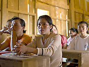 Laos is the most bombed country, per capita, in the world with more than 270 million cluster bomb submunitions dropped on it during the Vietnam War from 1963 to 1974. The Mines Advisory Group (MAG) are a humanitarian organisation clearing the remnants of conflict worldwide and have been working in Lao PDR since 1994. The community liaison teams are the eyes and ears of MAG, their job is to go out and liaise with communities to find out what and where the problem unexploded ordnance (UXO) problem is. The villagers of Ban Kua watch as Community liaison officer, Maneevan Khodlakham draws a rough map of the village in consultation with them to show where past UXO accidents and visible UXO are located.