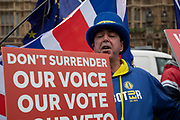Anti Brexit pro Europe demonstrator who has become known as Mr Brexit protests waving placards in Westminster opposite Parliament on the as five days of Brexit debate begins on 4th December 2018 in London, England, United Kingdom.