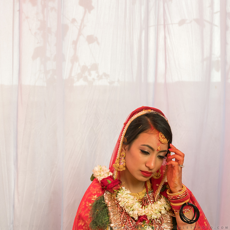 The bride before the start of the last part of her wedding ceremony. This is the last day of a Hindu wedding that lasted 7 days. Soon, the Bride will leave her home.